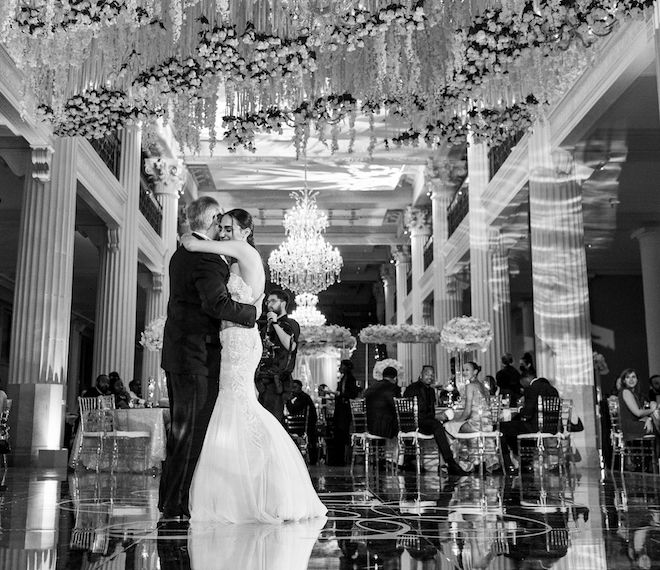 Bride holds on to her father while the two dance in a father daughter dance in the center of the ballroom at the Corinthian Houston.