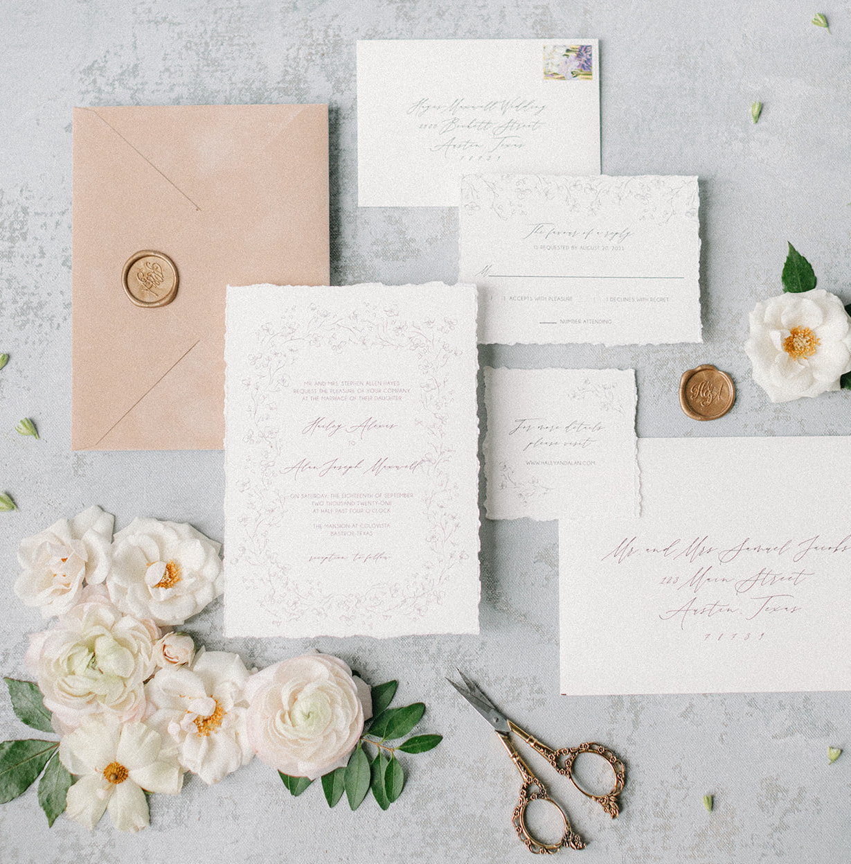 Flat lay of artfully designed southern invitations and stationary.