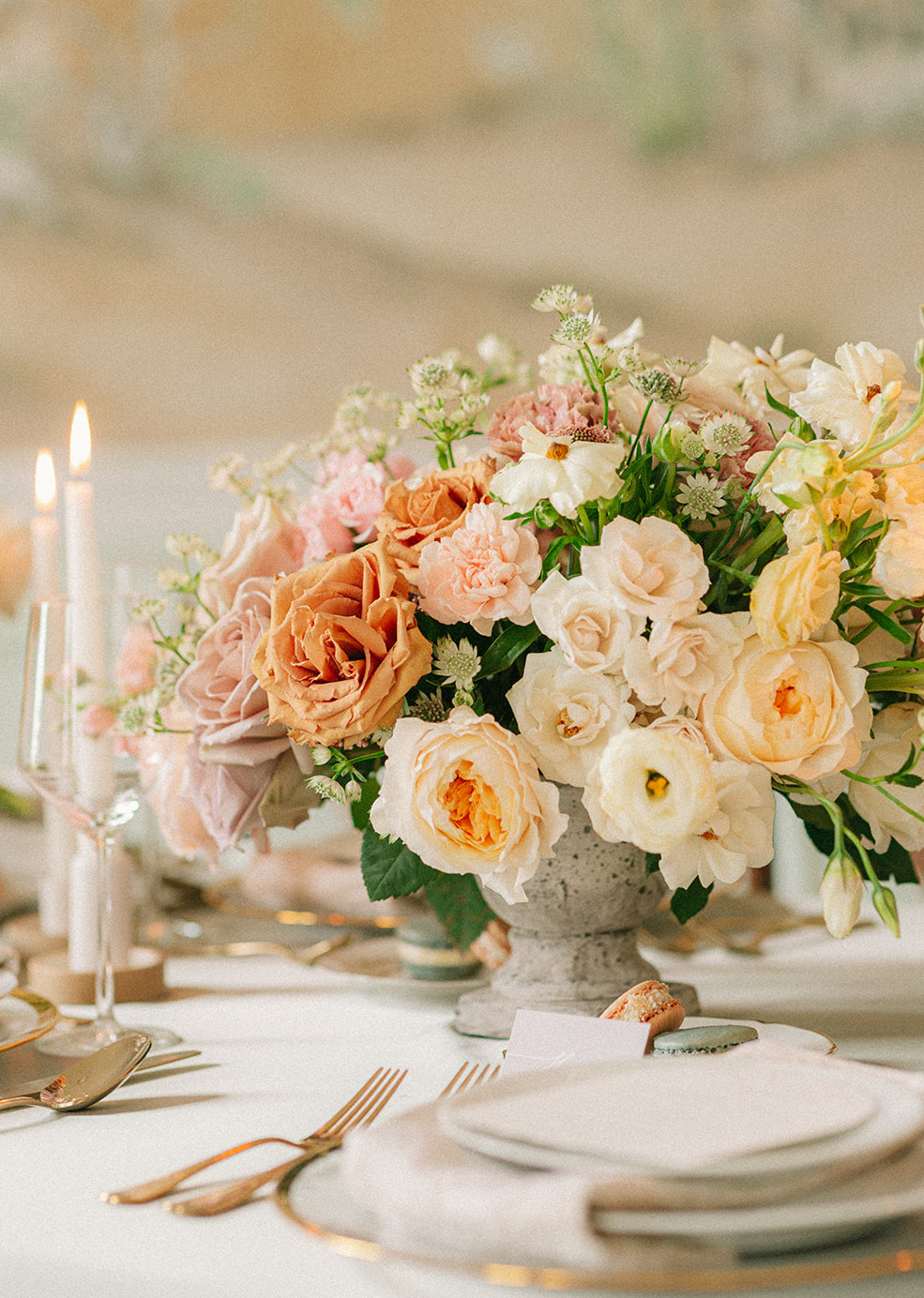 Artfully curated flower arrangements with garden roses and hill country wildflowers in buttercream, copper and peach hues.