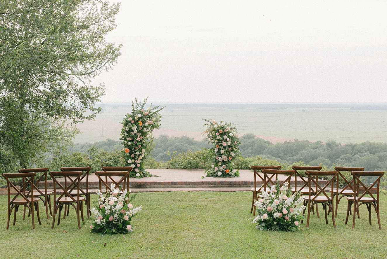Artfully curated southern hill country wedding ceremony set up.