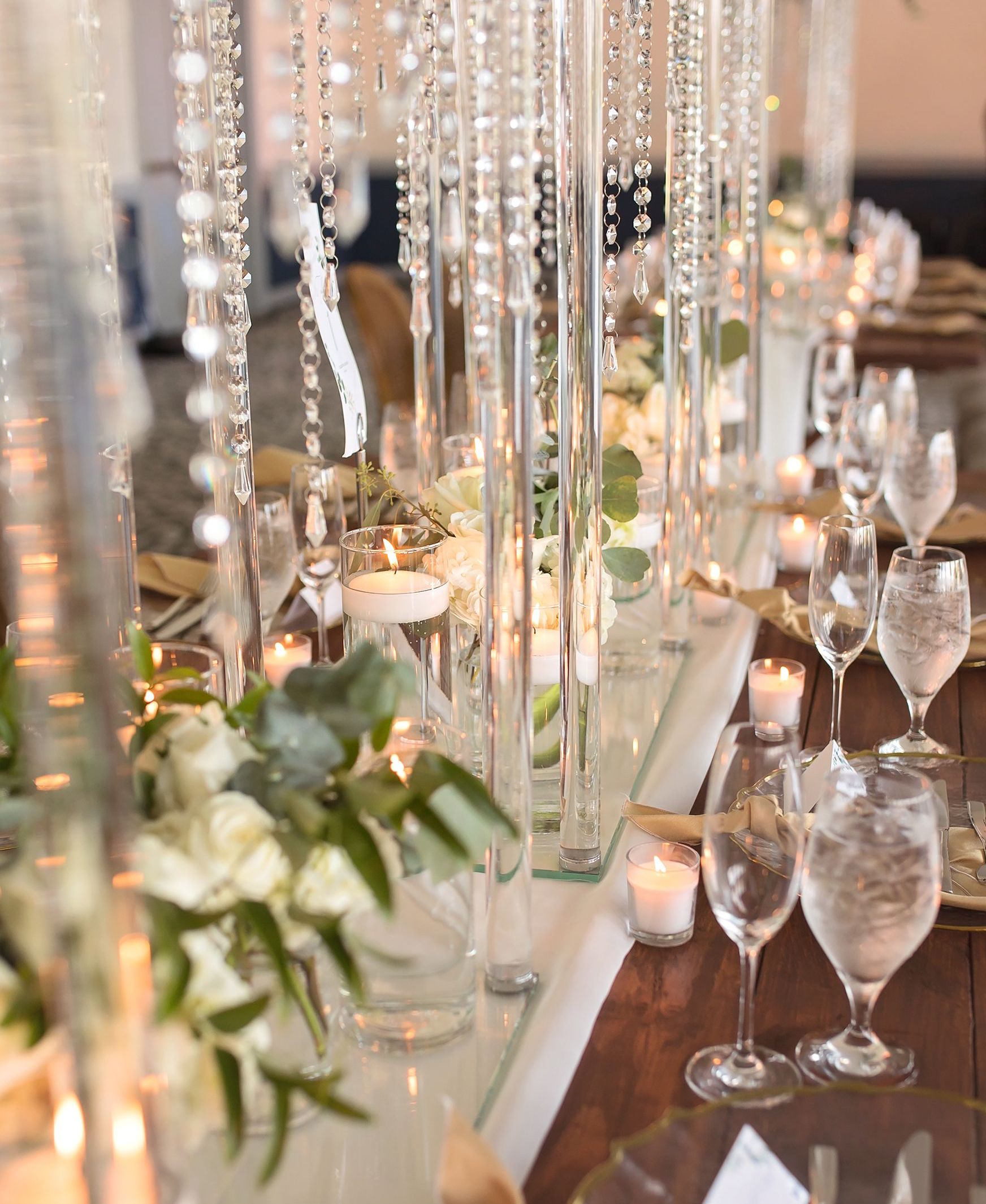 Crystal beads suspending from the table wedding centerpieces.