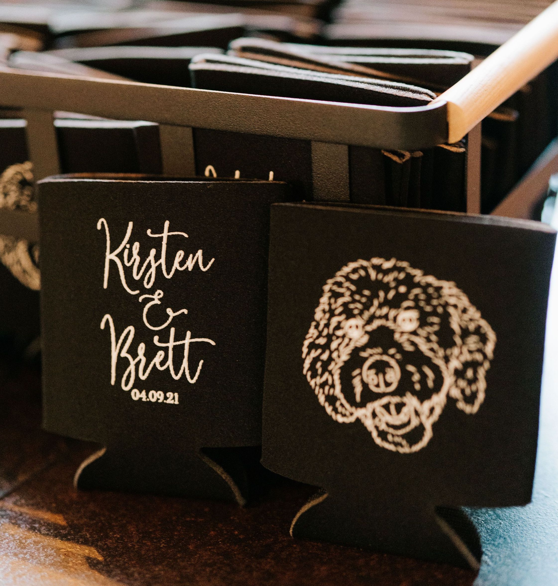 Kirsten and Brett's wedding favors were black can cozies with a cute white cartoon portrait of their dog, Moose.