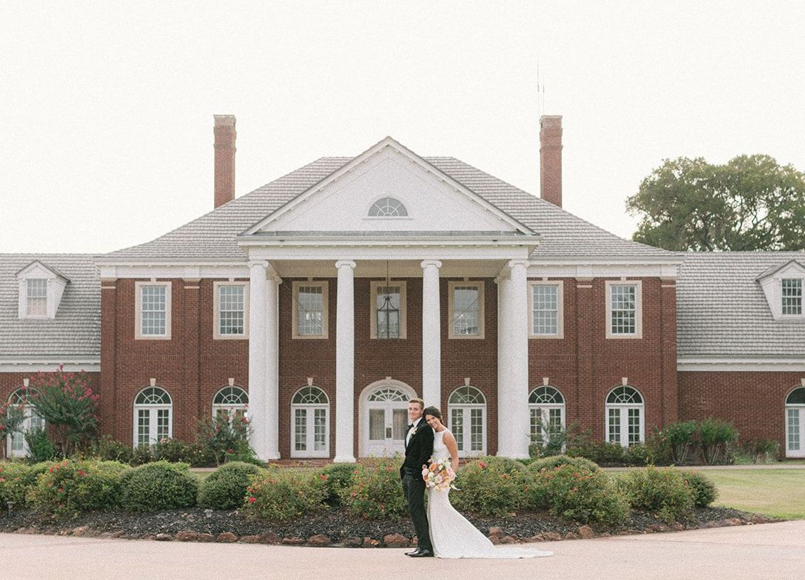 Bride and Groom stand in front of their southern venue, The Mansion at ColoVista, for their styled shoot.