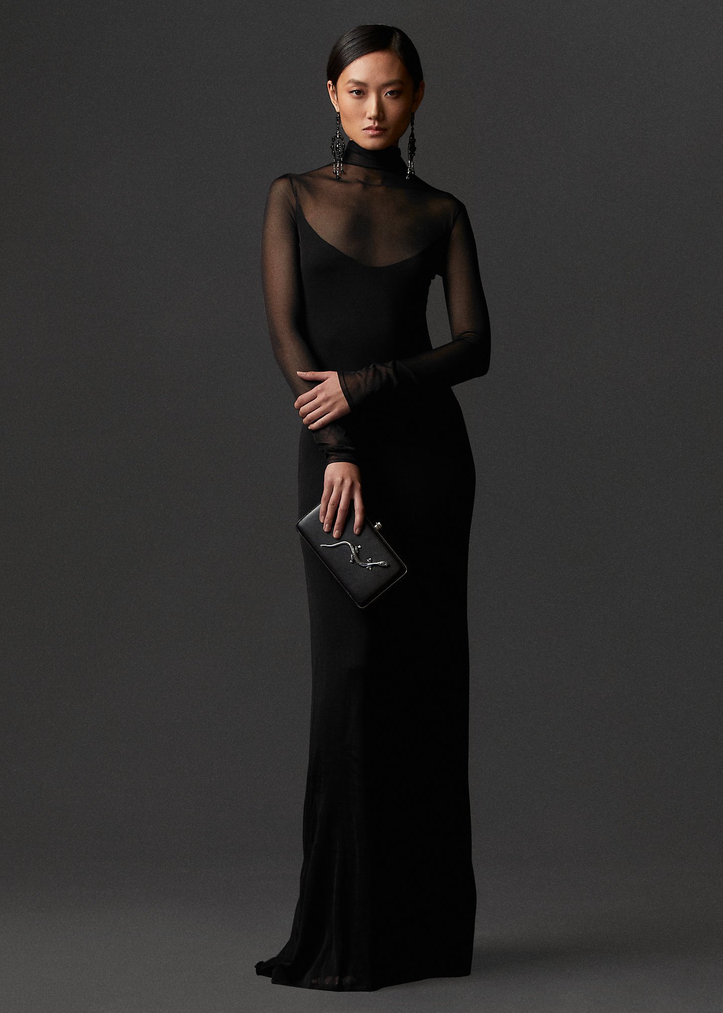 All black gown with sheer long sleeves and a turtleneck by Ralph Lauren for winter wedding guest.