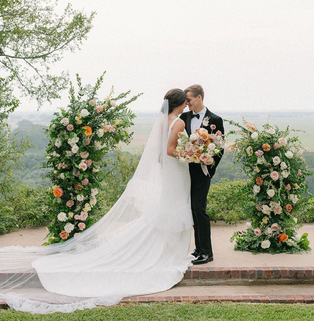 Bride and Groom embrace at the alter during their hill country artfully curated styled shoot.