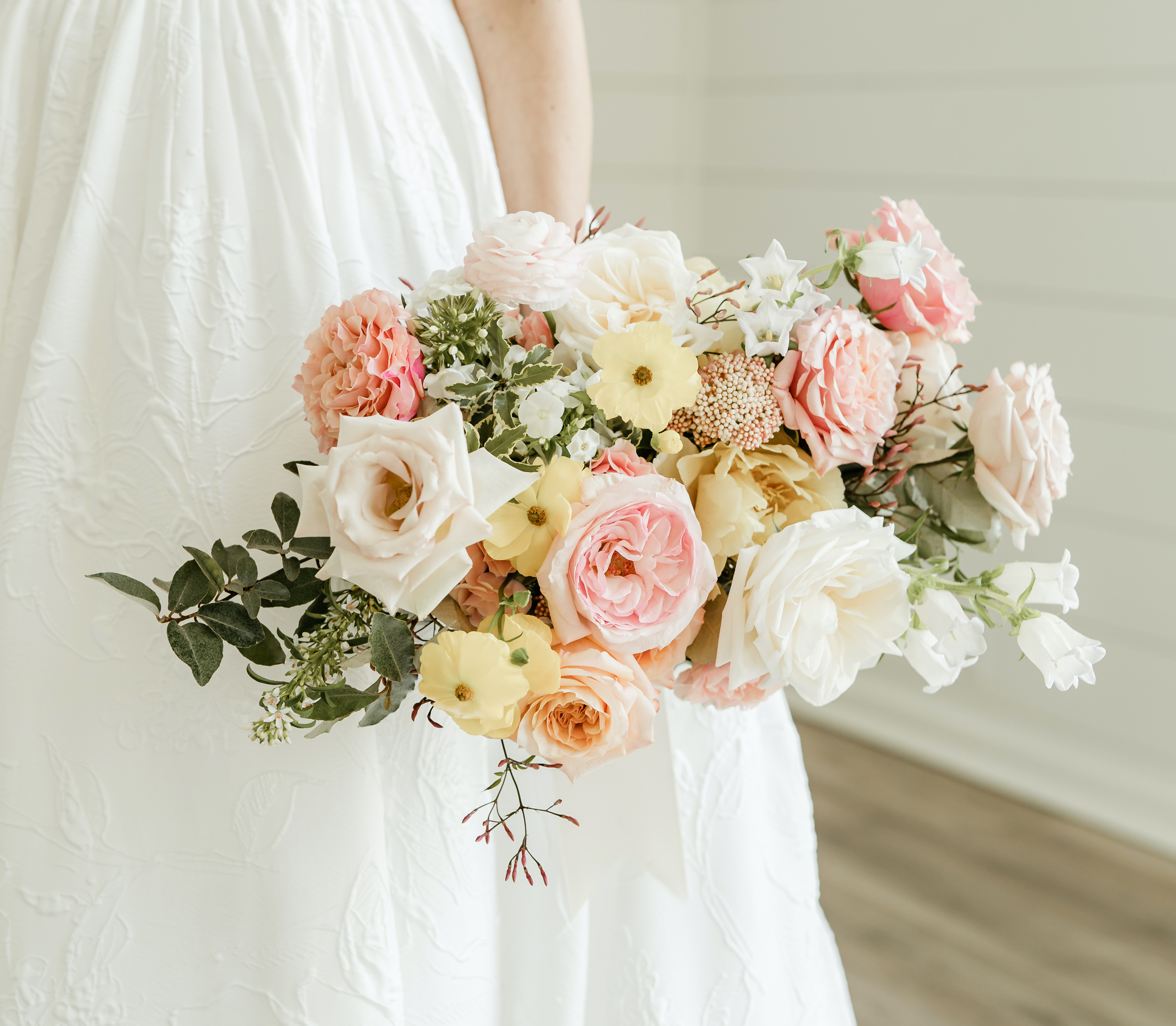 The bride's colorful bridal bouquet with pops of yellow and pink.