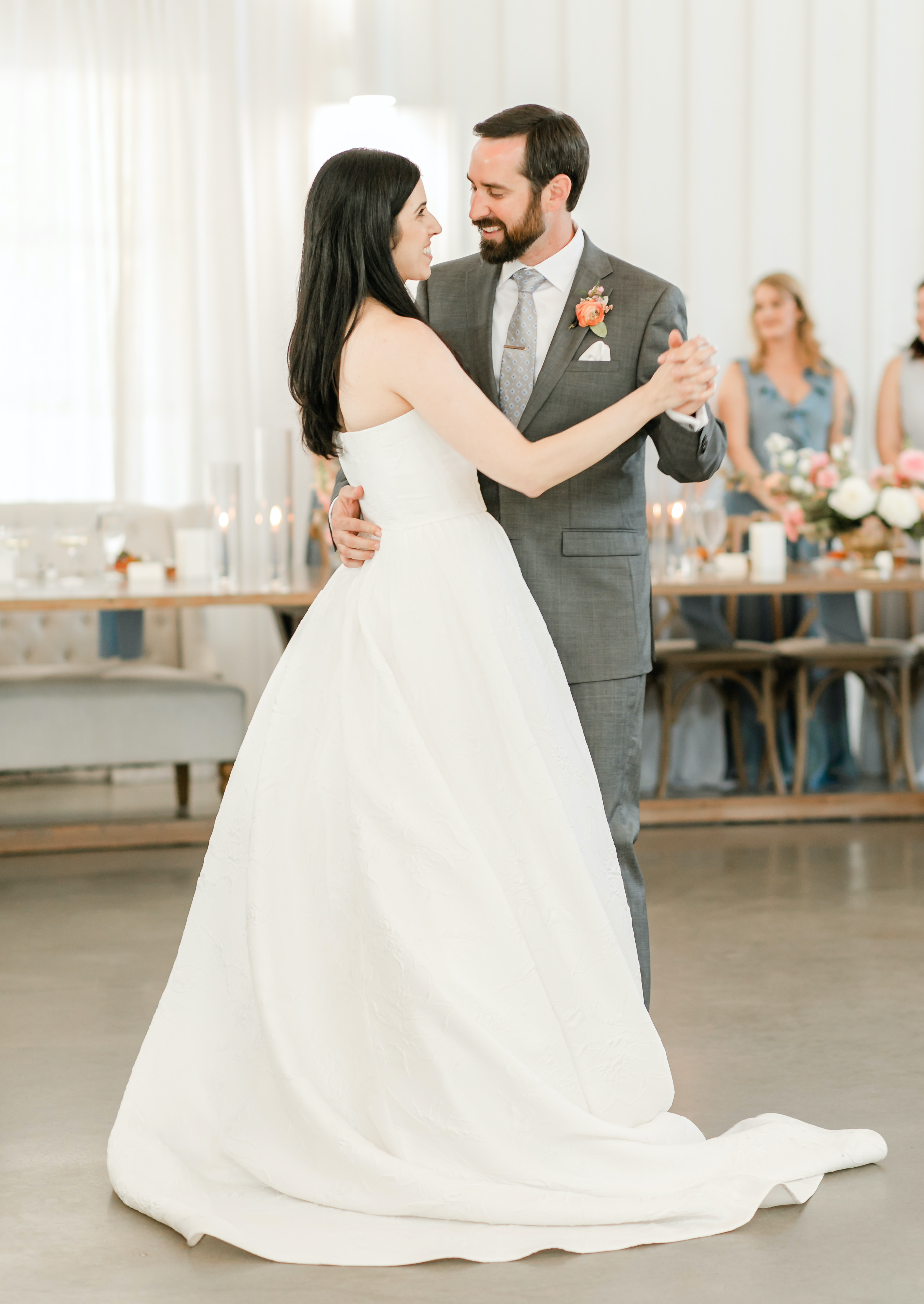 The bride and groom dance in the reception room.