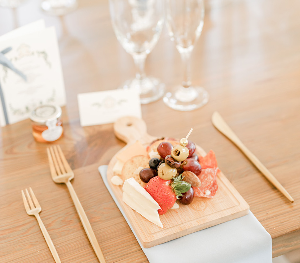 Personal charcuterie boards for the bride and groom's friendly spring wedding.