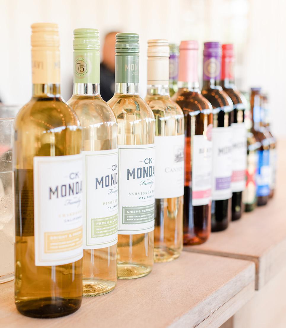 Wine bottles set at the bar in color order.