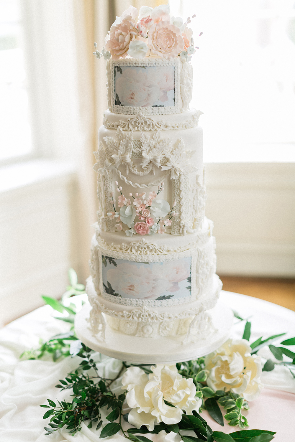 white detailed wedding cake