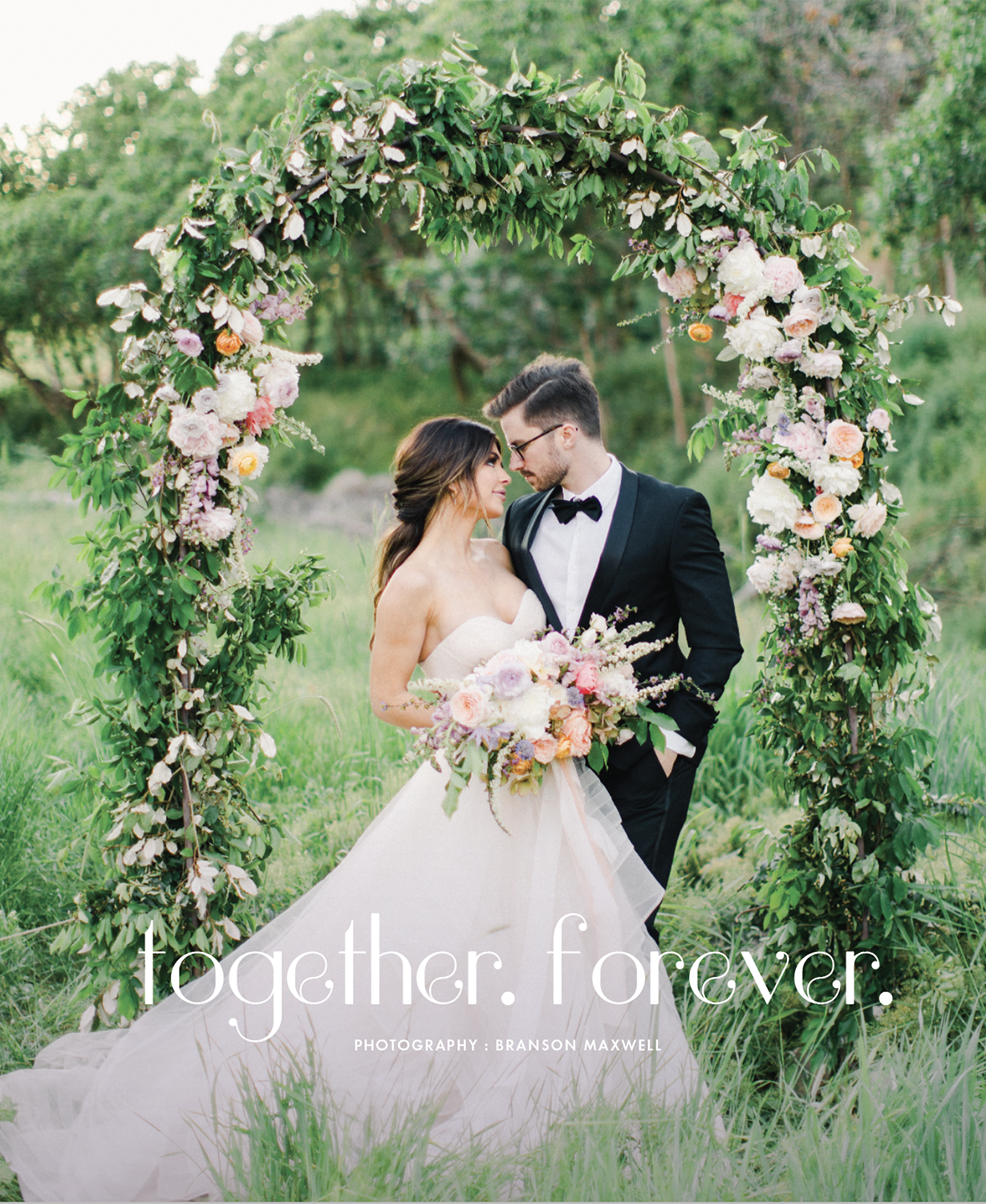 Together Forever features a gorgeous floral arch, a stunning tablescape and a beautiful couple in a romantic garden setting. Photography: Branson Maxwell