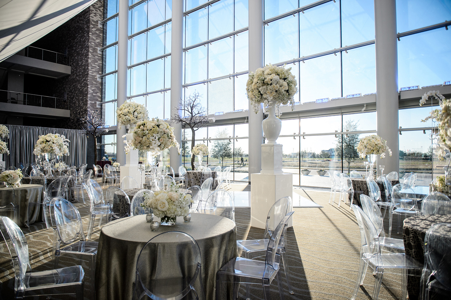 bright flowers, sparkly linens, big windows for houston wedding venue