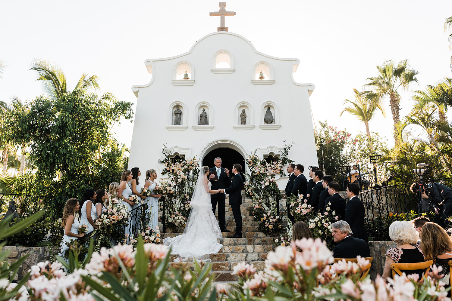 stucco, chapel wedding ceremony in mexico - flowers - blush, cream