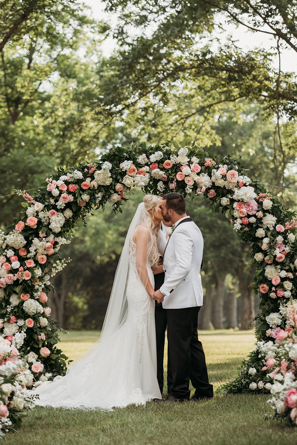 outdoor wedding ceremony - floral arch