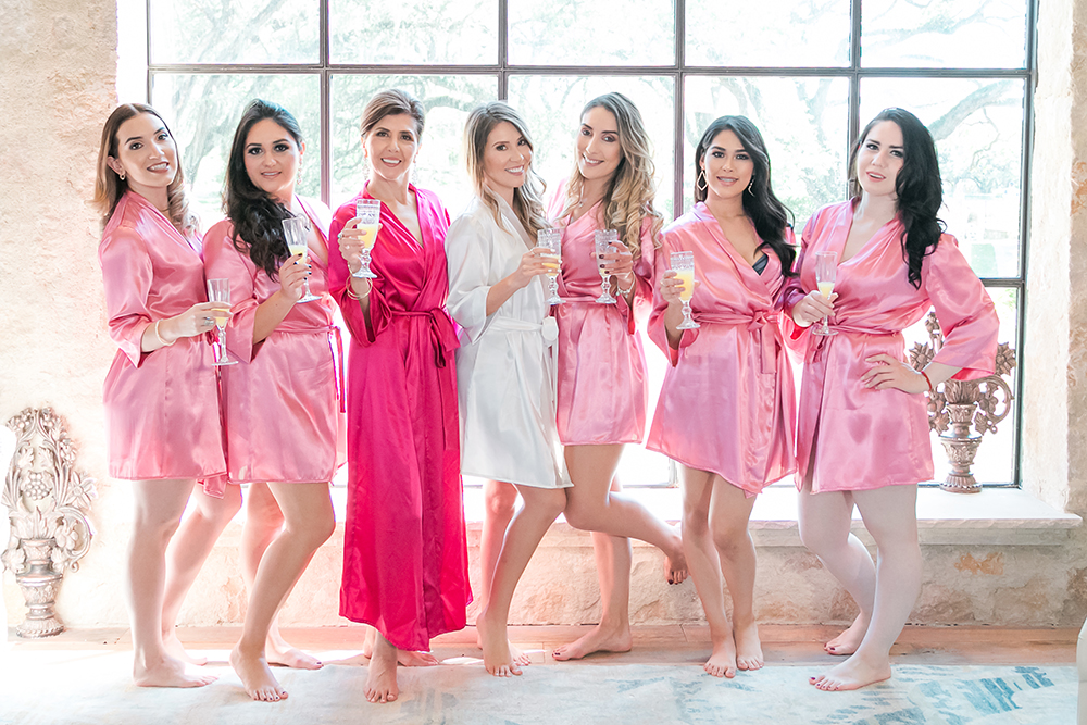 bridesmaids pink robes in bridal suite