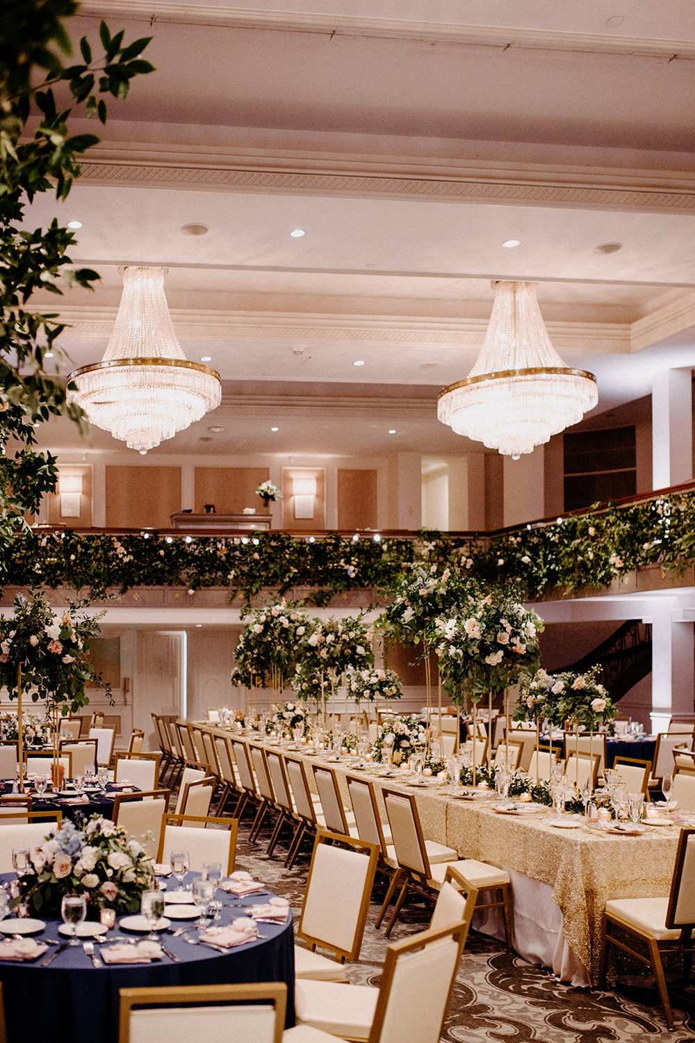 wedding reception decor - crystal chandeliers - greenery