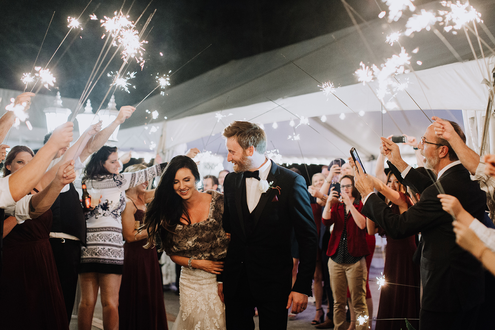 couple exit, sparklers, bride, groom, wedding photography