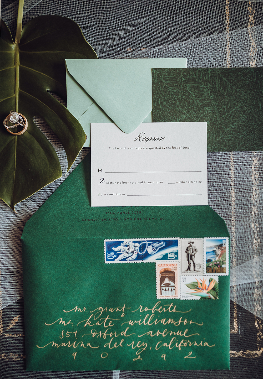 flat lay - stationary - invitations - green - tropical