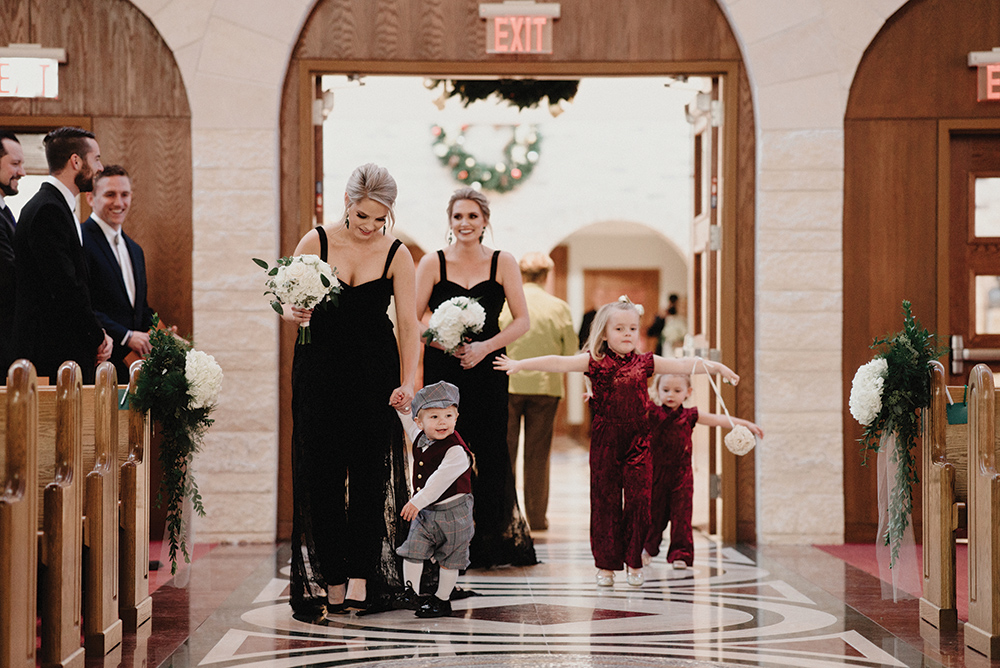 bridesmaids walk down the aisle - church - pantsuits