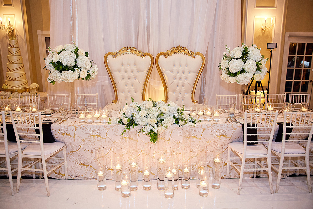 his and her chairs at wedding reception
