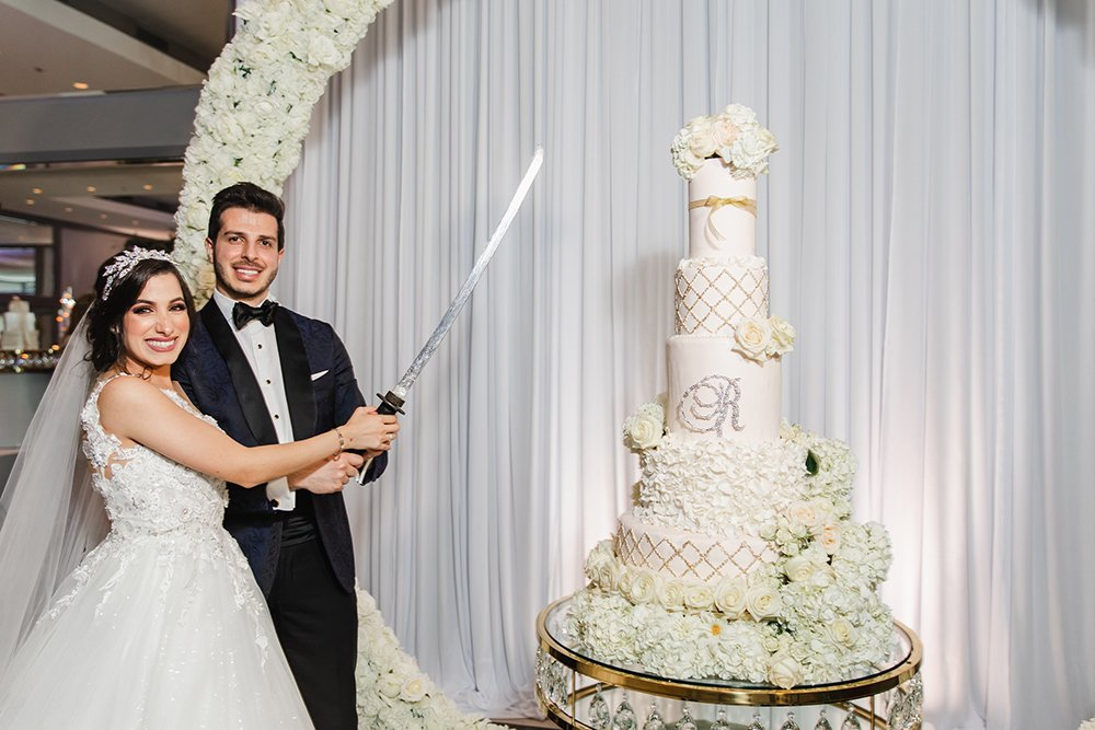 cutting the cake - wedding - sword - middle eastern