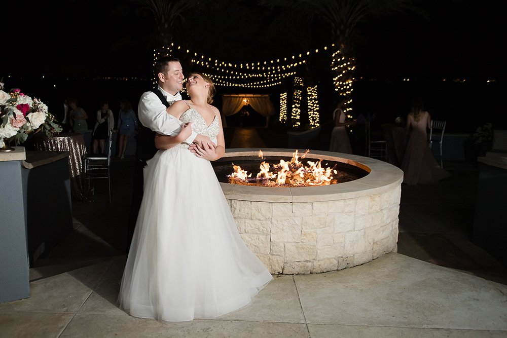 romantic first dance, patio, outdoor, reception, fireplace, string lights, nighttime photography