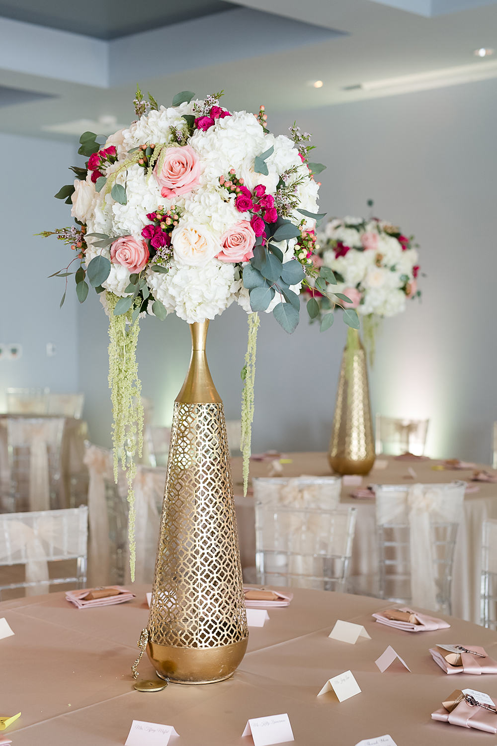 blush and gold reception decor for ballroom wedding