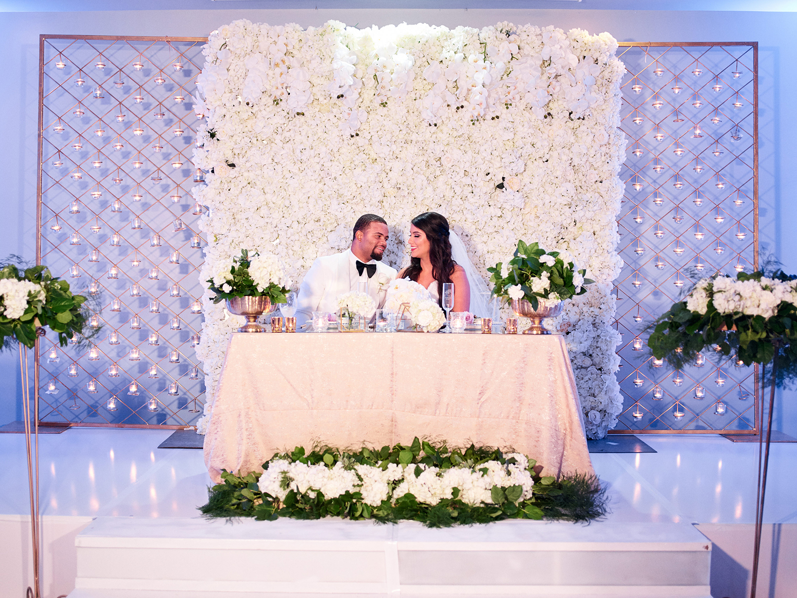 lavender, ivory wedding reception decor and lighting
