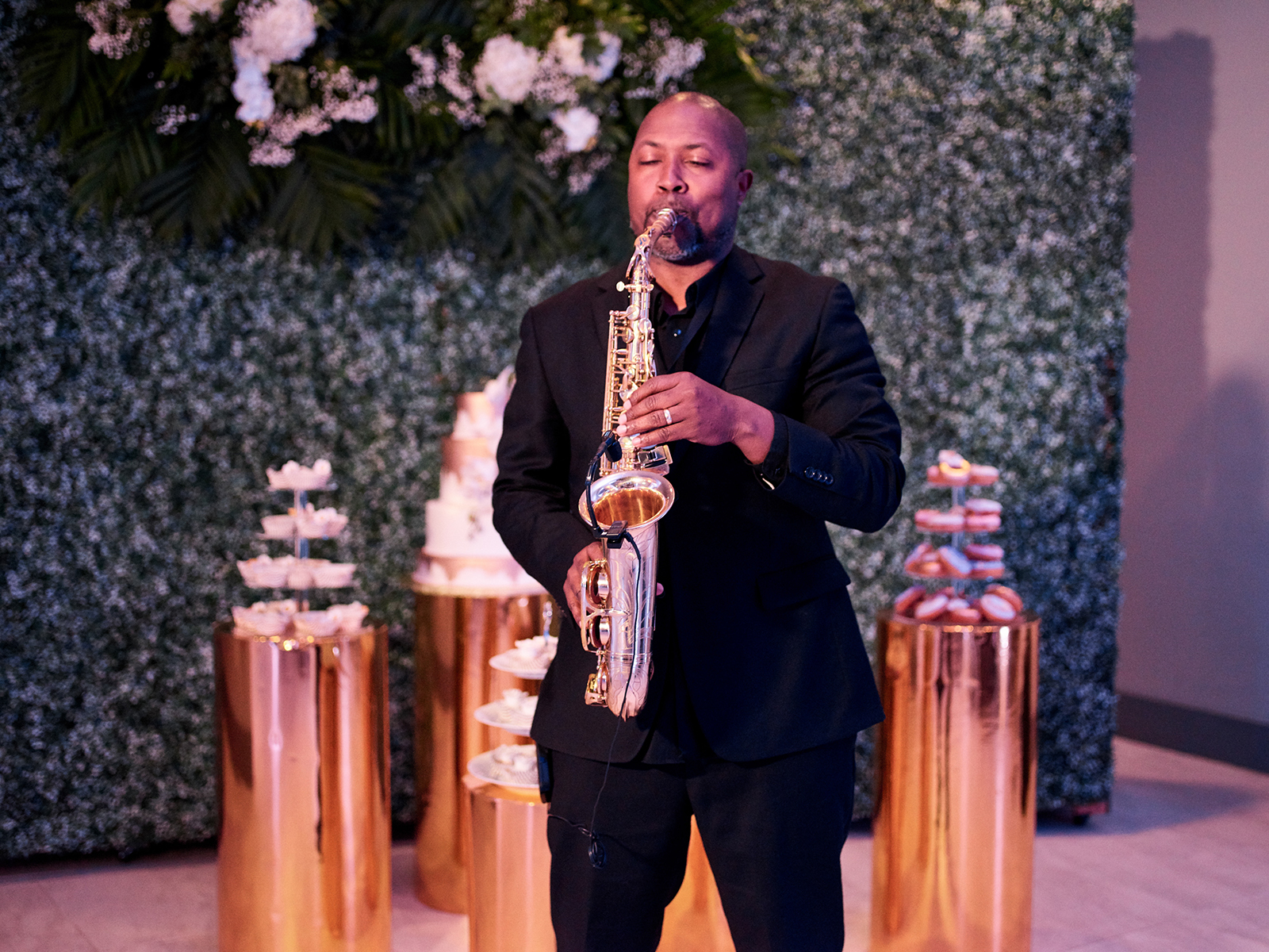 gold cake stands, ivy wall, saxophone at wedding
