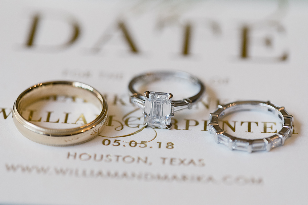 wedding bands and engagement ring on invitations