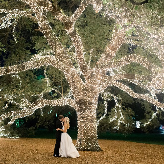 giant lit tree with newlywed couple - houstonian - wedding photography
