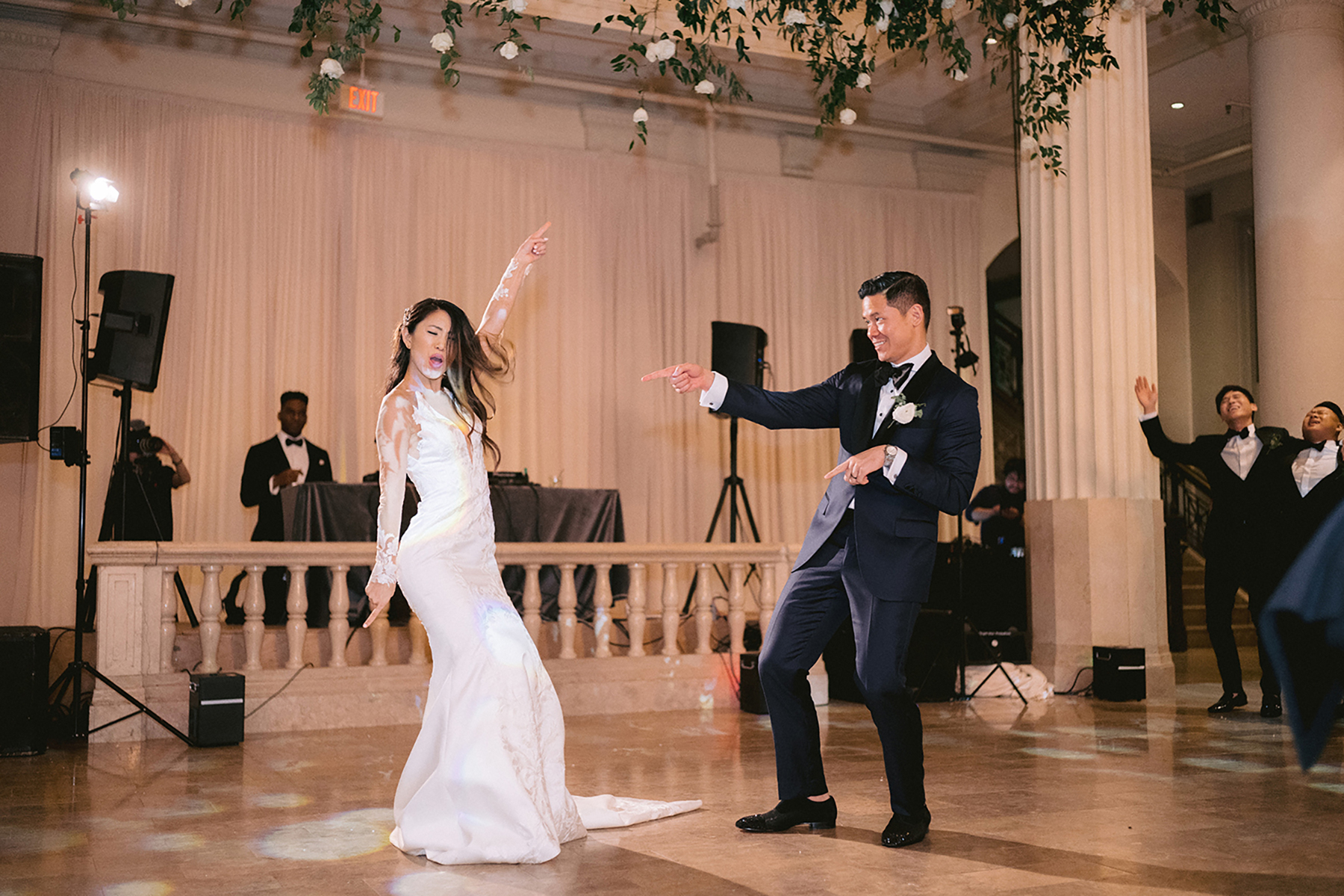cute dancing photo of newlywed couple