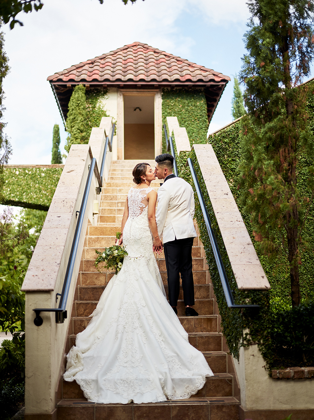 wedding gown on steps at the bell tower on 34th - houston venue