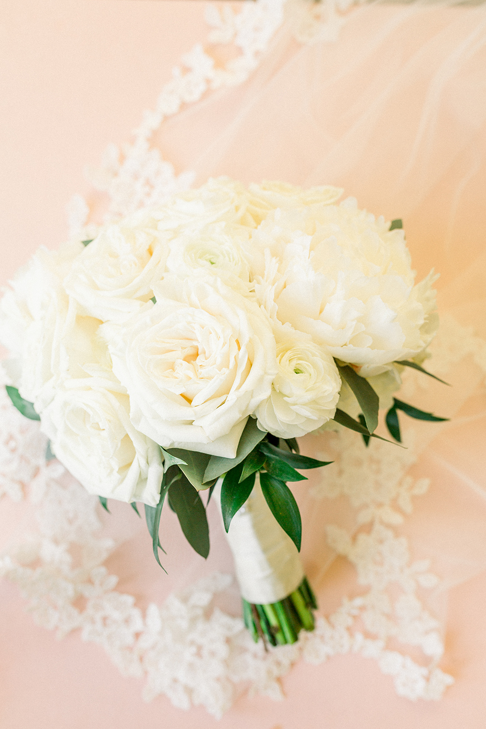 white bouquet with blush background