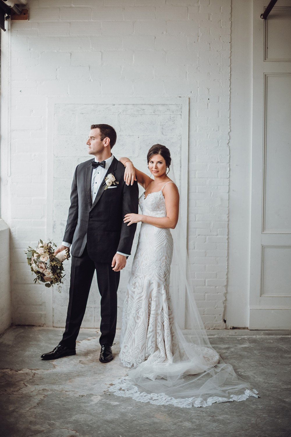wedding photography of the couple, bouquet in hand