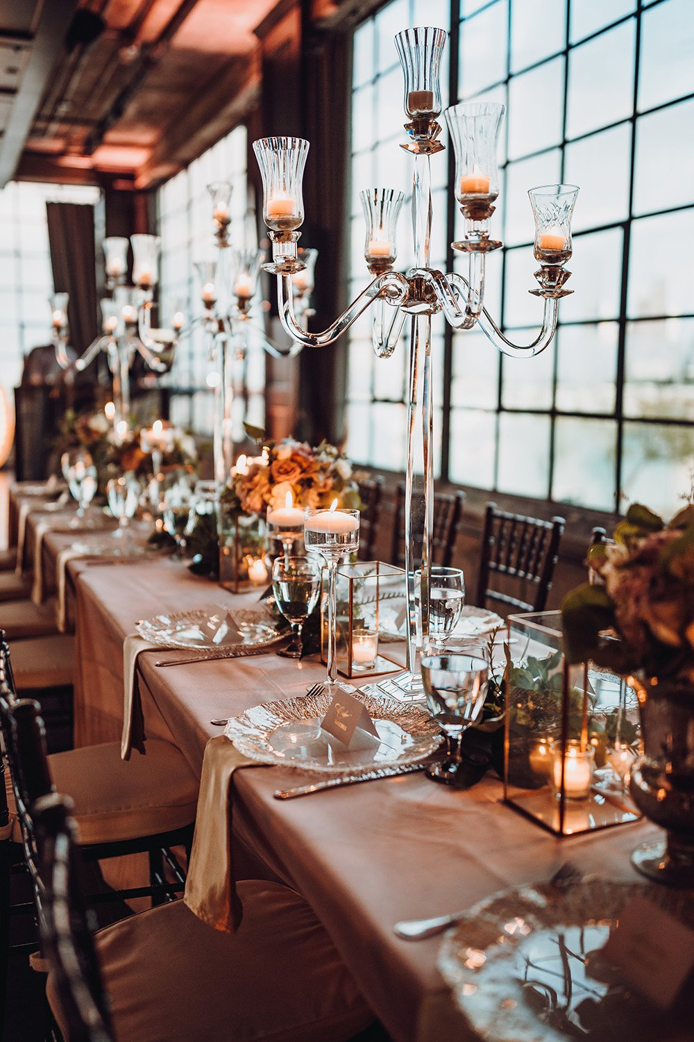 blush tablescape with candles and details