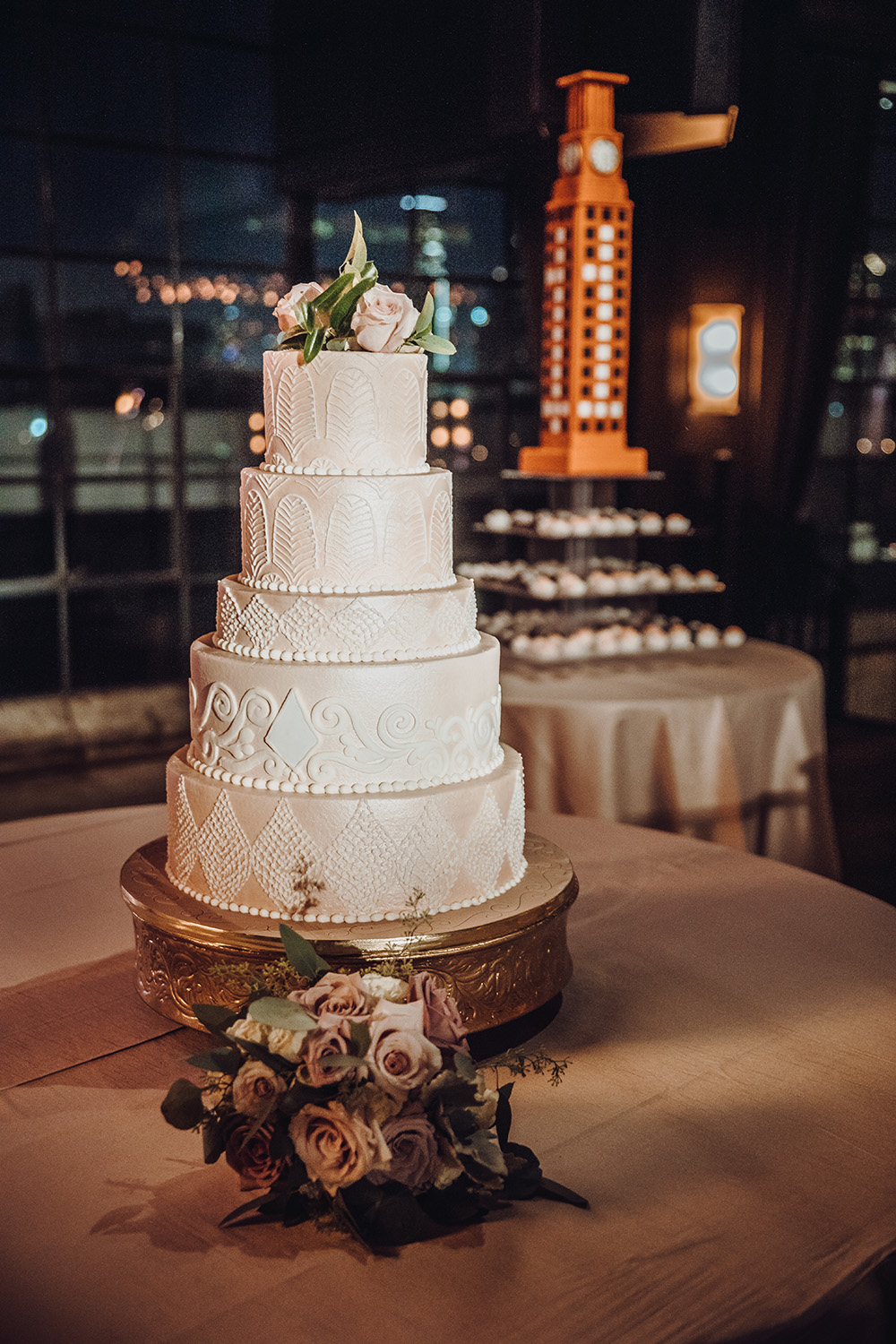 white wedding cake on gold cake stand