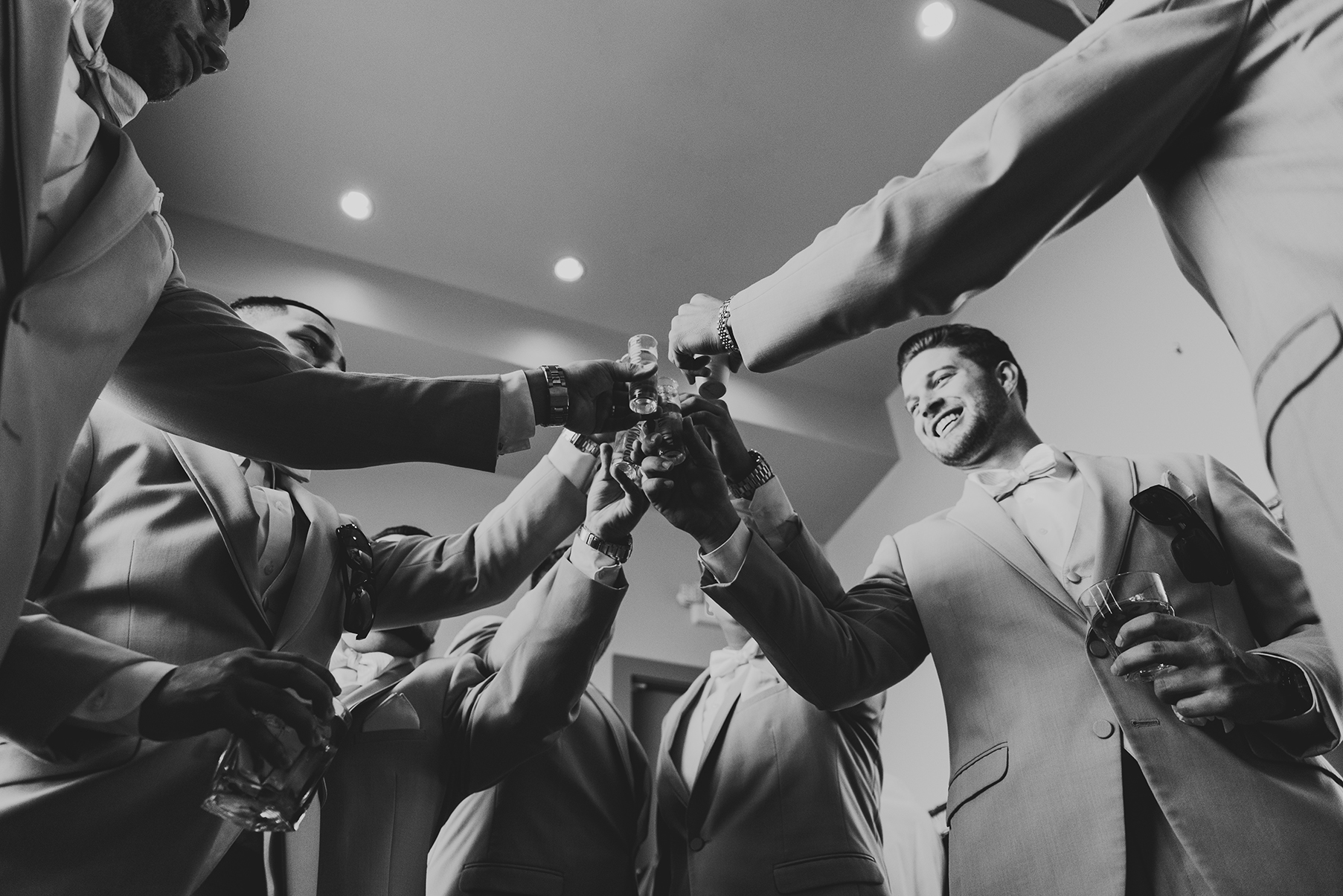 houston wedding, getting ready, toast, groom, groomsmen, black and white