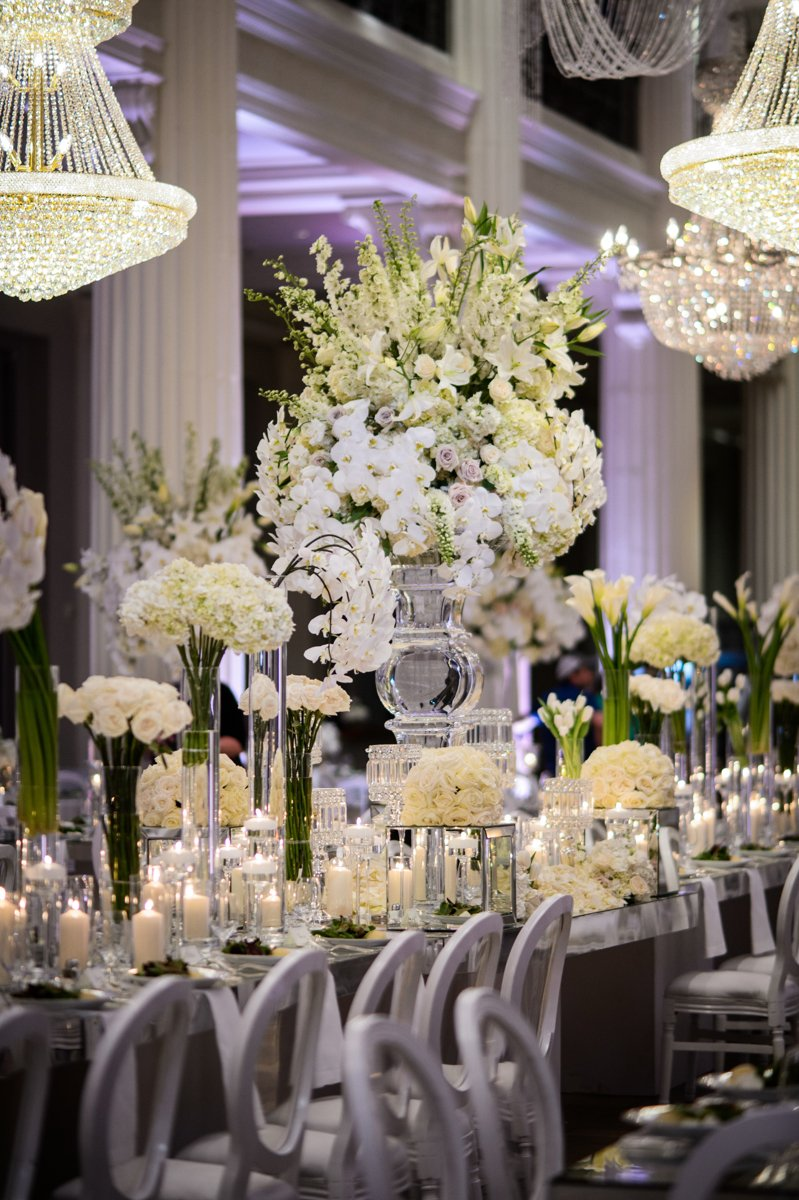 long table flowers, chandeliers, decor at corinthian houston