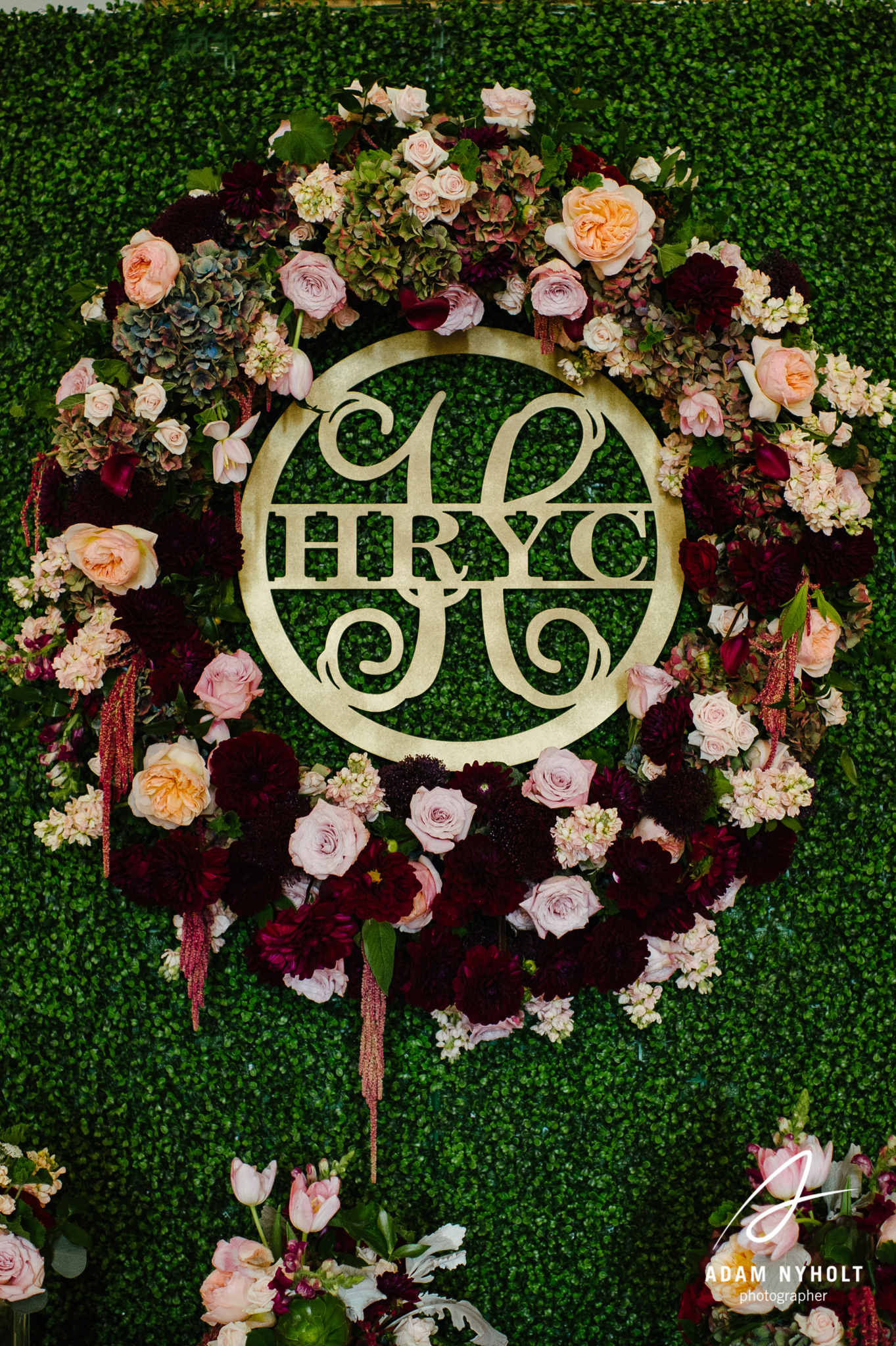 Floral Wreath around monogram at wedding - flower wall