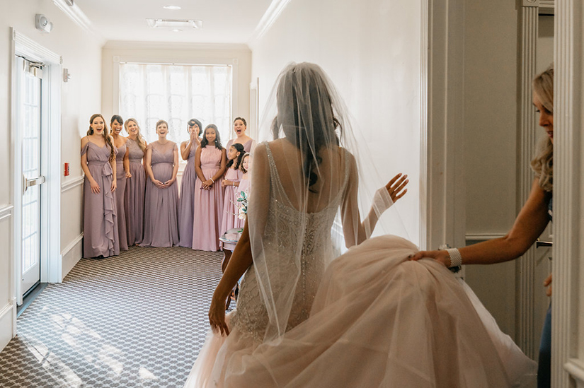 wedding photography of bride's first look with bridesmaids
