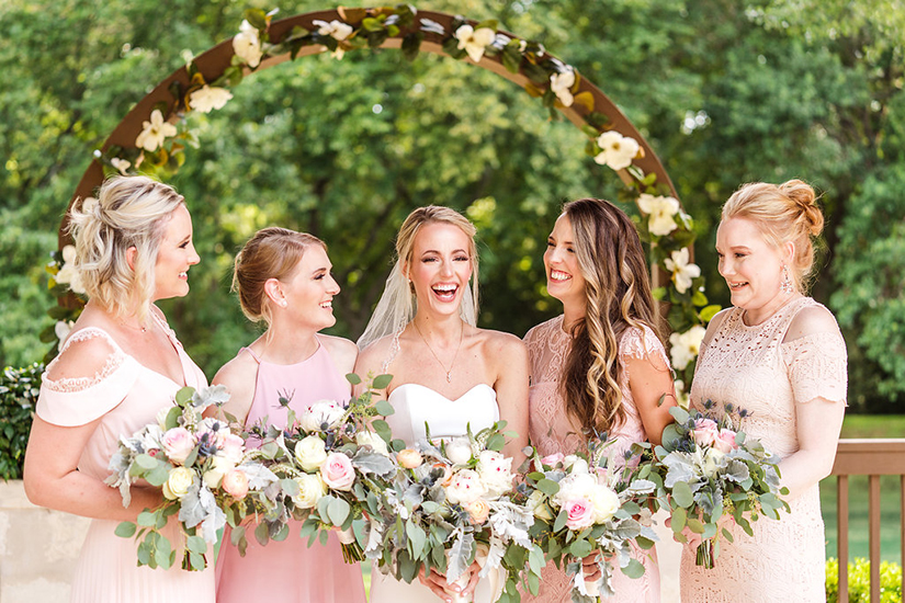 wedding photography of a bride with bridesmaids