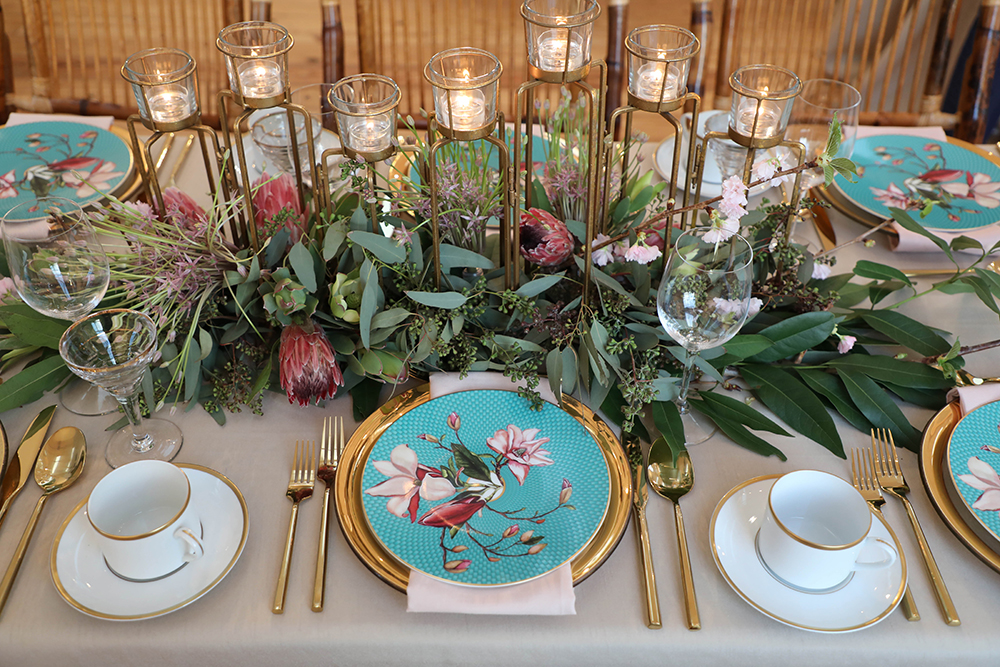 blue, teal and gold plate settings - table scape decor rentals